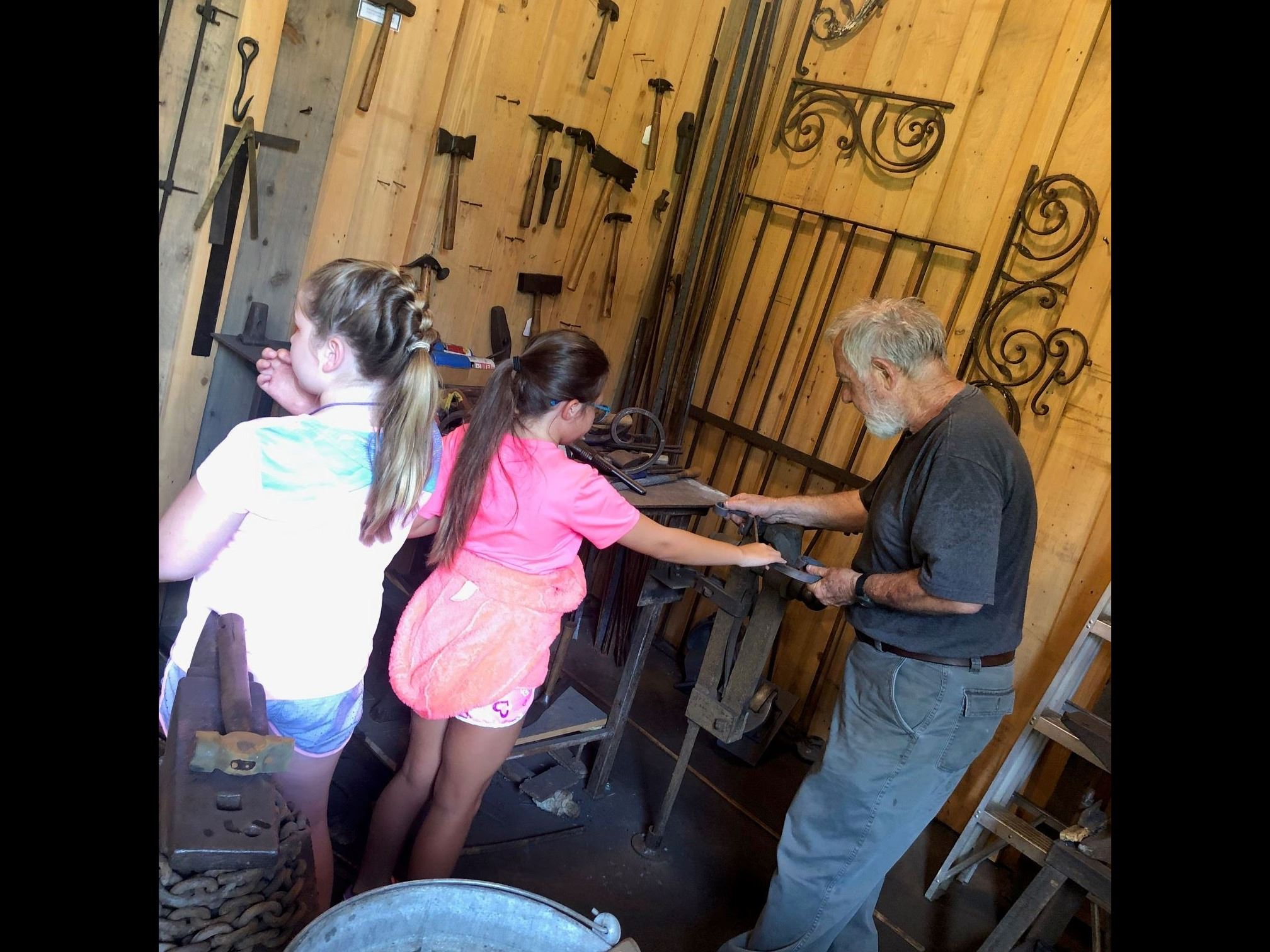 Children observing Blacksmith